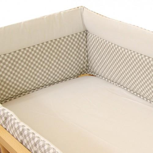 Ochraniacz do łóżeczka . Saro - biały / przybliżenie